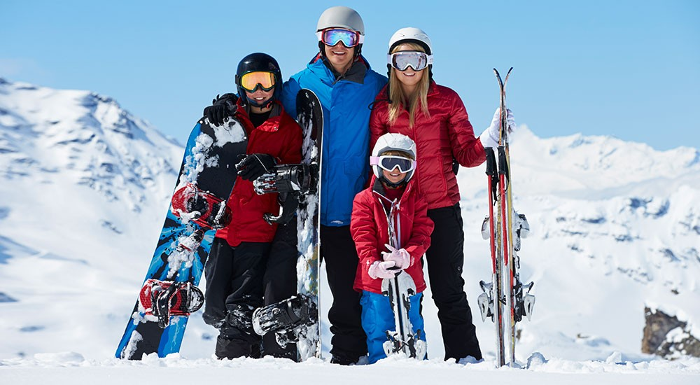 People skiing or snowboarding on a mountain