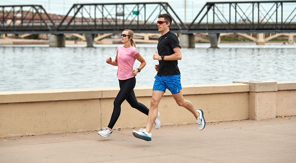 Man and woman running in running shoes