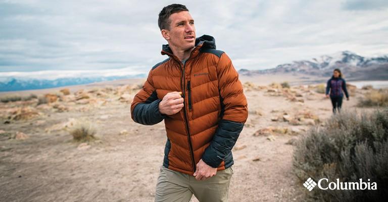 a man zipping up a puffer jacket