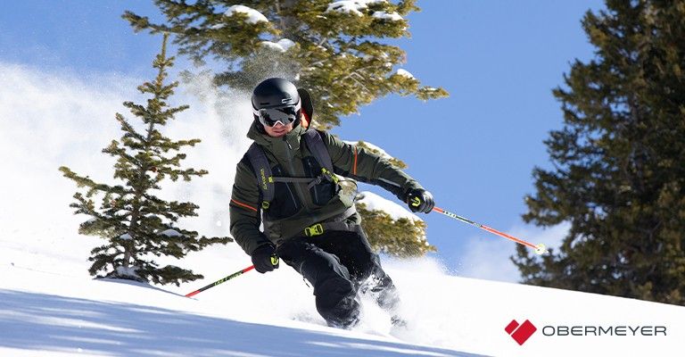 a man wearing a ski jacket while skiing