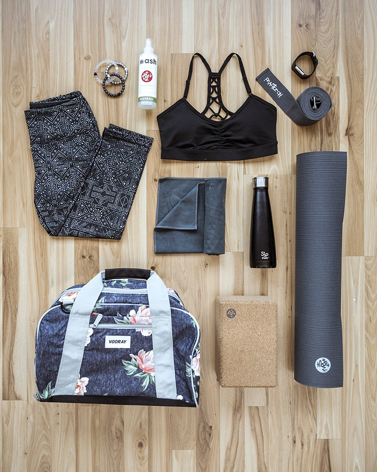 Image of a yoga accessories like a yoga mat and yoga towel