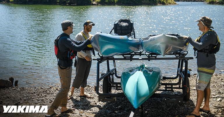 people getting kayaks off a yakima rack