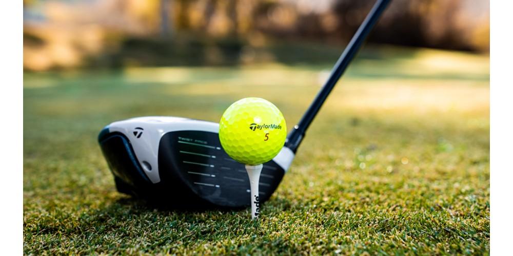 a golf tee, golf ball, and golf driver
