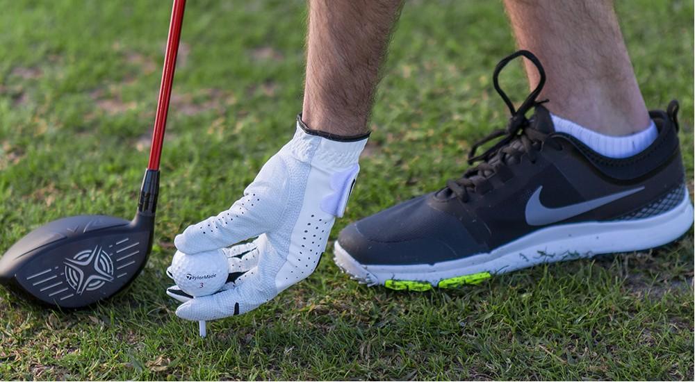 a beginner golfer with golf essentials