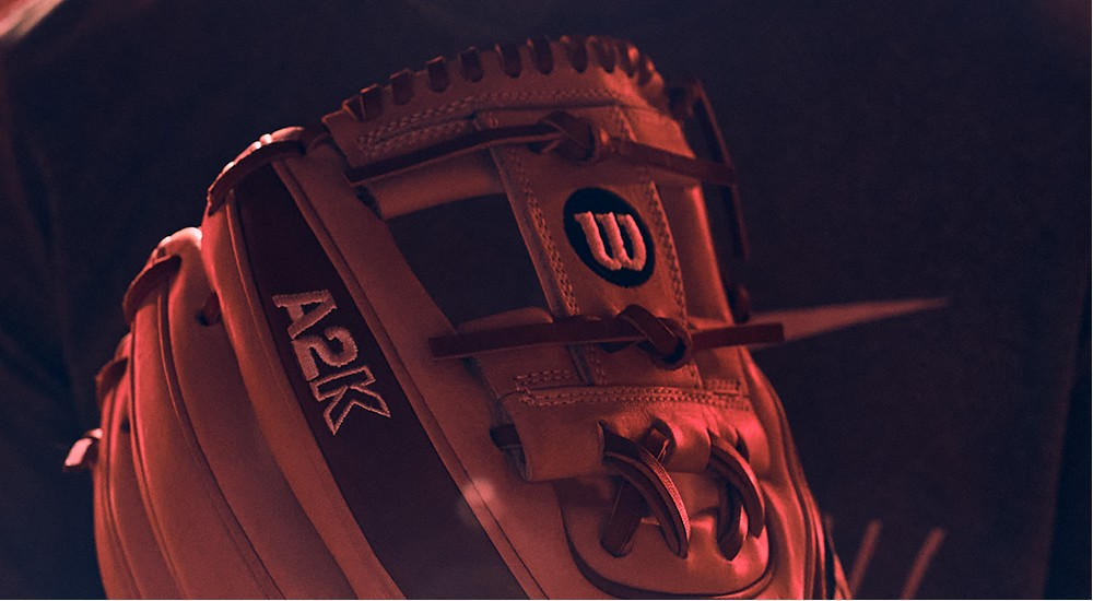 Baseball player holding a broken in baseball glove