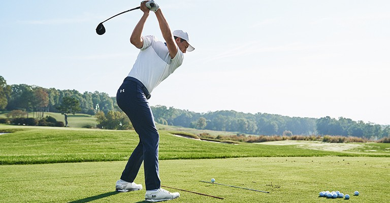 male golfer wearing golf clothing