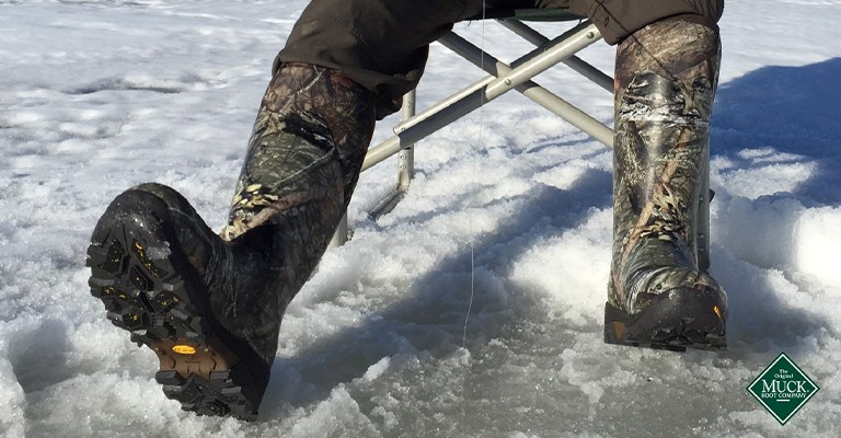 a man wearing insulated snow boots ice fishing