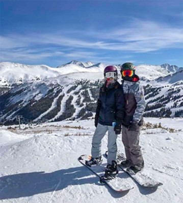 Chase Magruder and wife snowboarding in Colorado