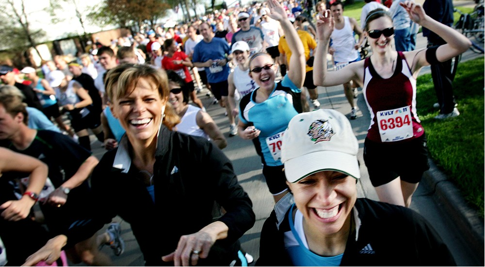A group of people running a 5k race