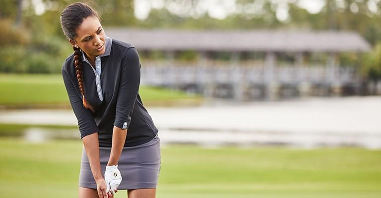 female golfer wearing golf clothing