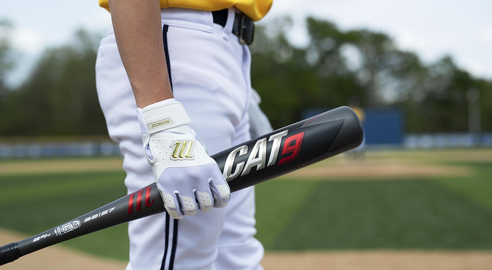 Baseball player about to use his new bat