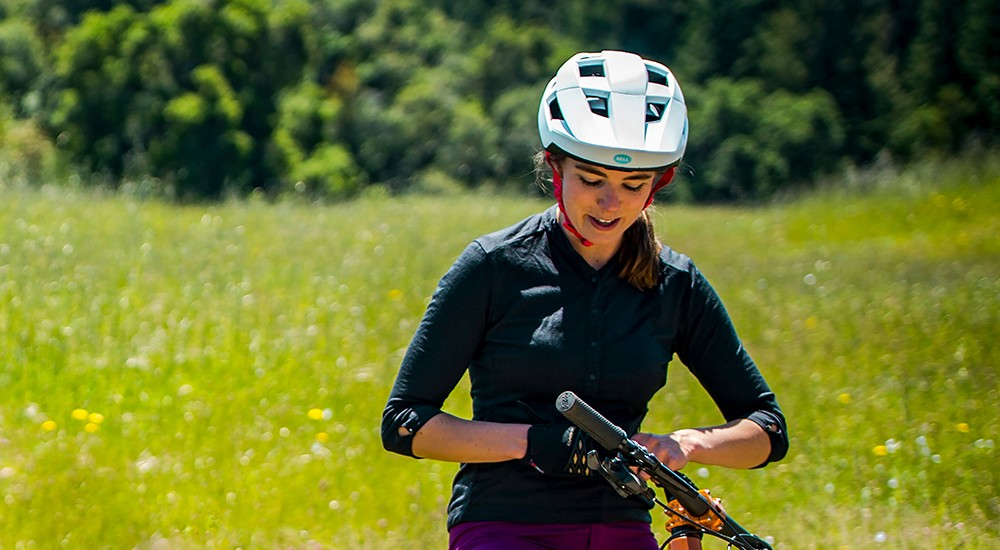People wearing a bike helmet while riding bike