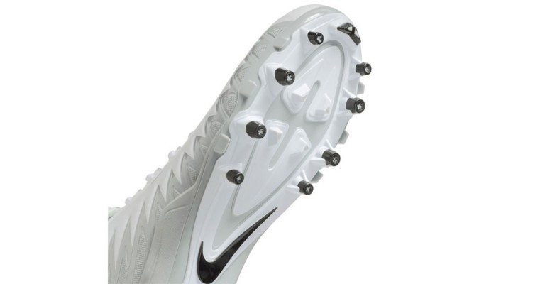 the bottom of a hard molded football cleat