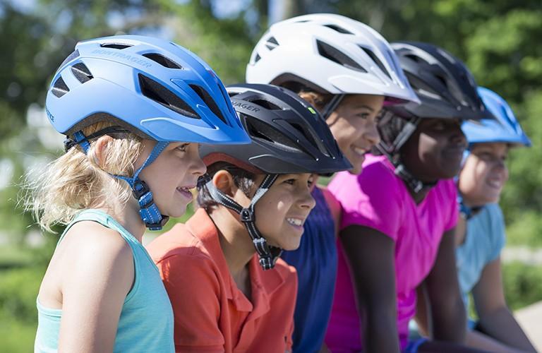Kids wearing their bike helmets the right way