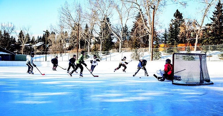 people playing hockey outdoors