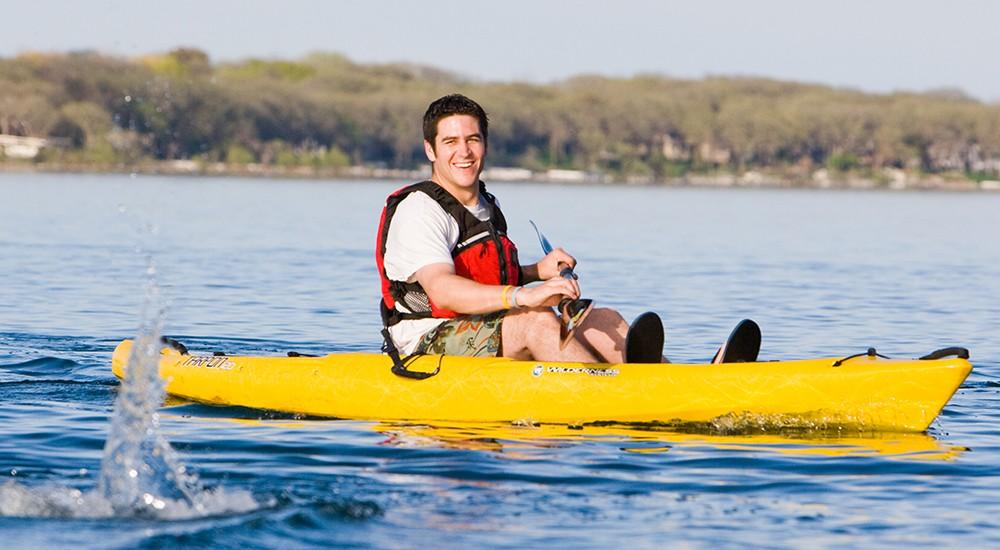 Man kayaking in a sit-in-top kayak