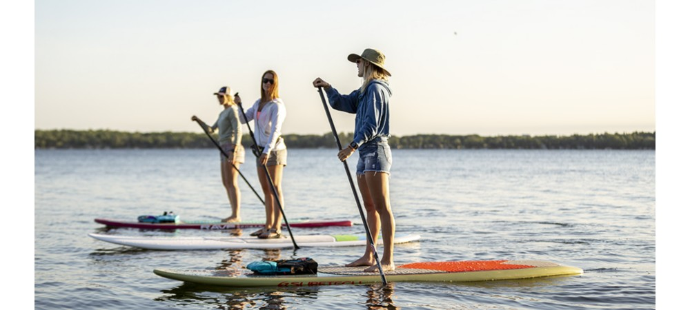 Different paddles on paddle boards