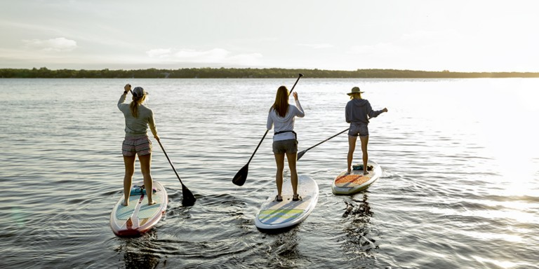 paddle board racing with friends