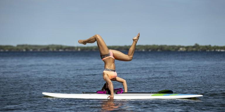 woman doing sup yoga