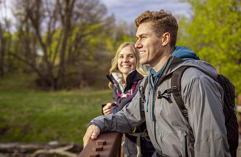 man and woman wearing rain jackets