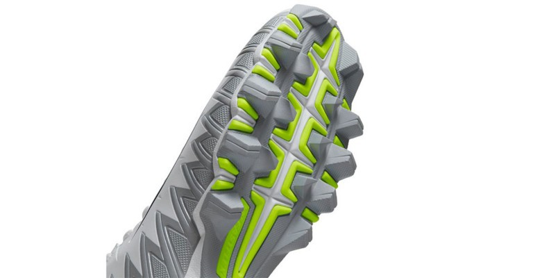 the bottom of a rubber molded football cleat