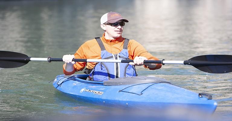 man sitting in a sit-in kayak