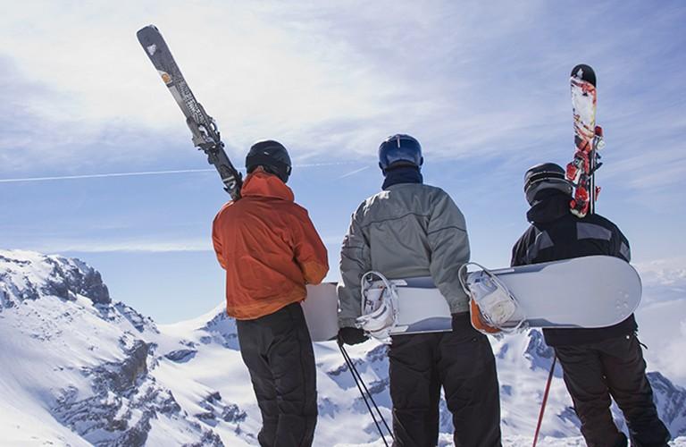 snowboarders and skiiers wearing helmets