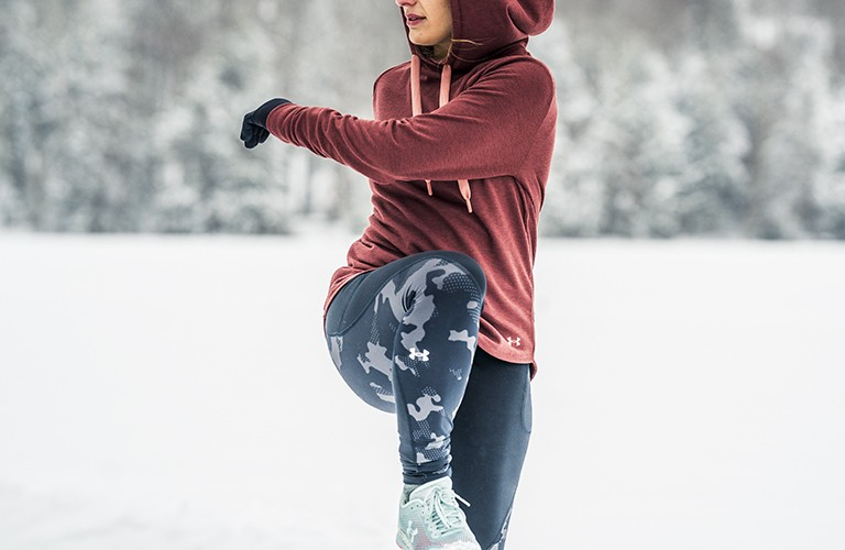 woman warming up for a cold weather workout