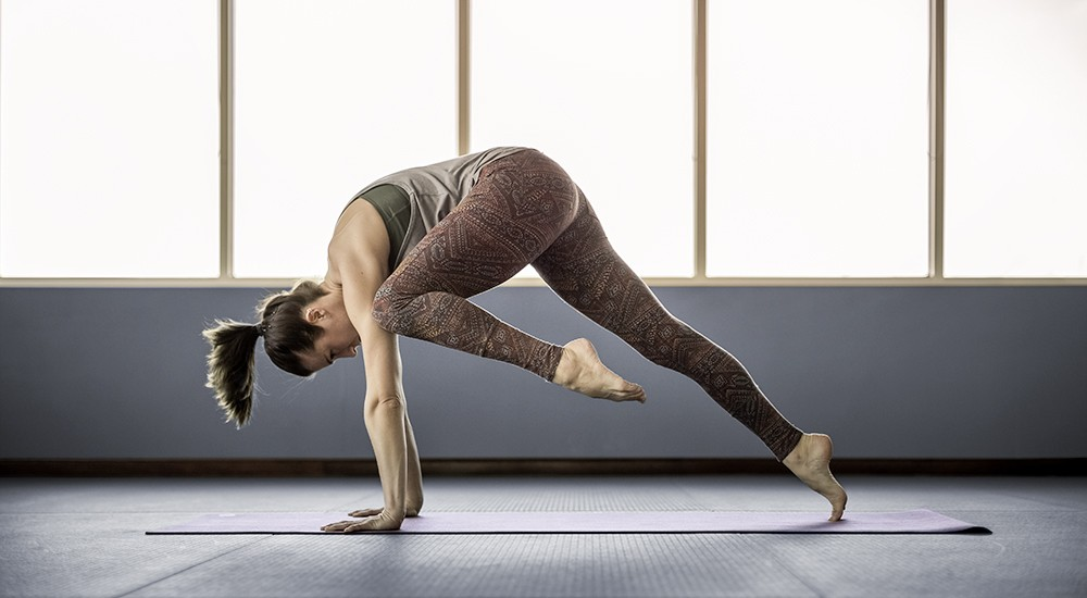 Person doing yoga at a yoga class