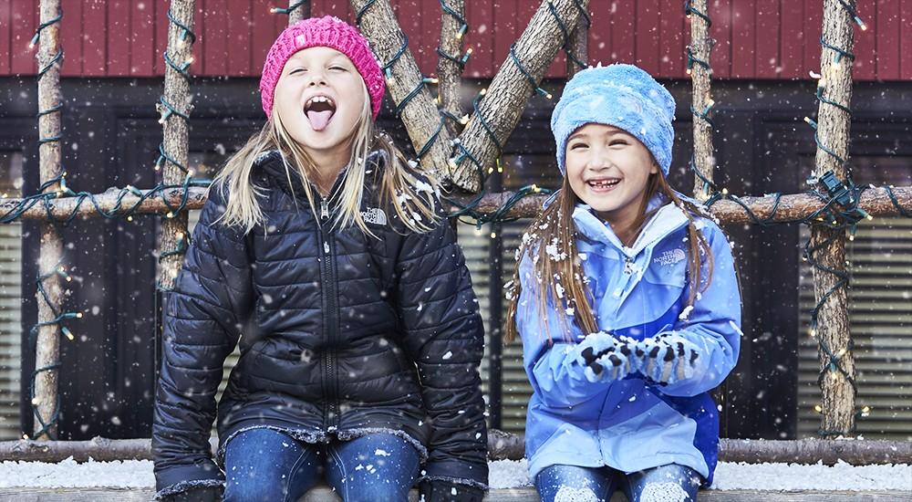 Kids wearing warm winter coats